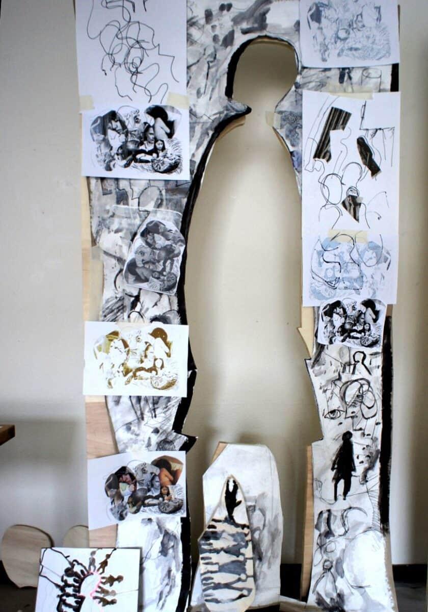 Bearbeitete Holztafel mit ausgeschnittener Figur von Regina Simon